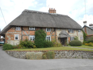 Grade II Listed Period timber framed house with a thatched roof